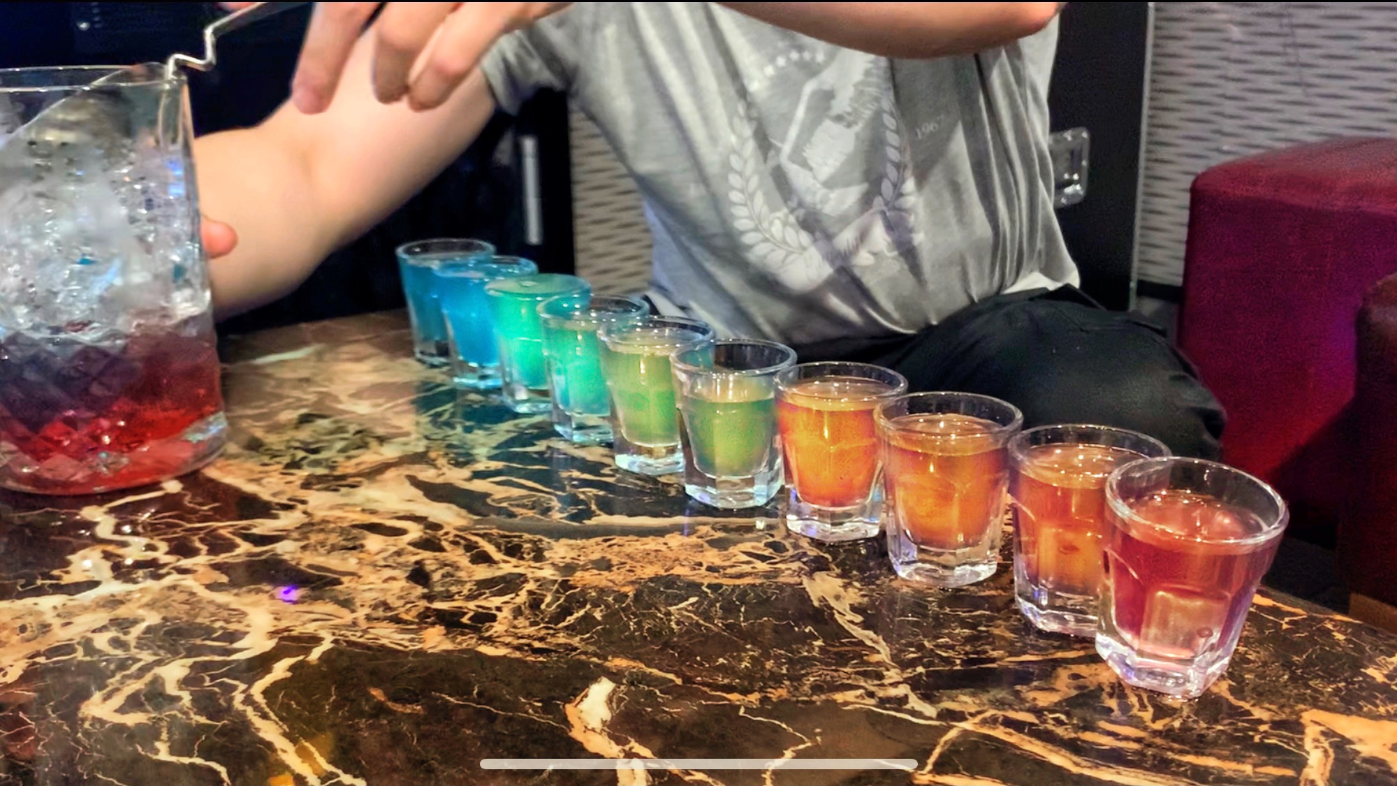 Rainbow shots at Queeraoke night.